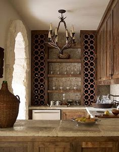 rustic home bar- great wine storage. Could probably do with PVC pipes painted whatever color goes with your decor.