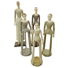 Collection of five carved, wooden decorative sculptures inspired by antique French mannequins, 20th Century.