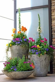 I want this for spring!! This is an example of my perfect planters! Love everything about it - colors are my favorite.