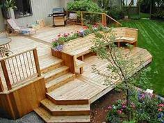 tiered deck with built in bench (not one the kids could use to fall over the rail)