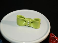 """Wasabi green polymer clay bow. 1.75"""" - has 3 faux pearls on the front. Bow can be used for crafts, pendant, pin, magnet - lots of crafts."""