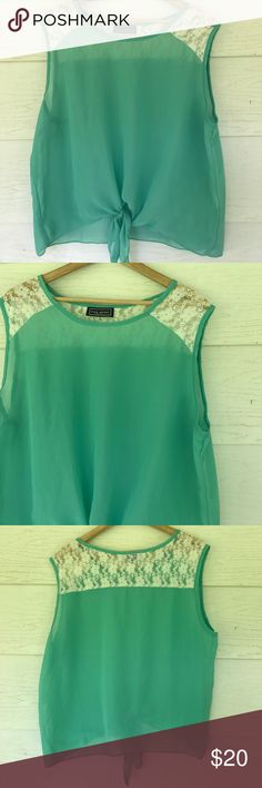 Green tie waist top Green sheer tie waist top. Sleeveless. Lace on shoulders. Size xl. 24 bust 23 length. All measurements are approximate Tops