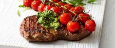 Pesto steak with balsamic tomatoes