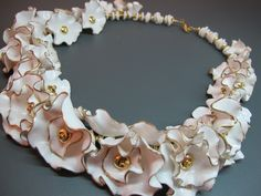 Necklace | Maria Theresia.  Gold and white polymer clay.