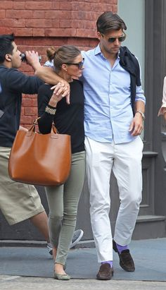Johannes Huebl in classic blue shirt and light beige chinos. Impossible to catch him without Olivia ;)