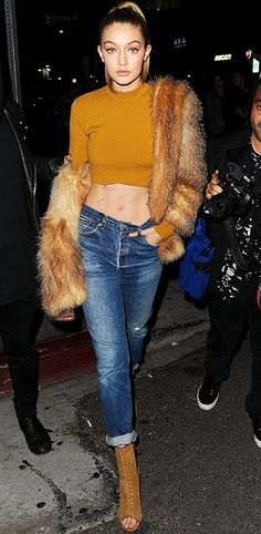 Gigi Hadid in a cute (sexy!) winter outfit: mock-neck crop top, fur coat, boyfriend jeans and peep-toe booties