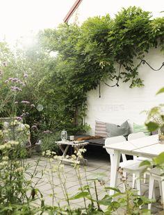 Charming garden space,tucked in the corner   adamchristopherdesign.co.uk