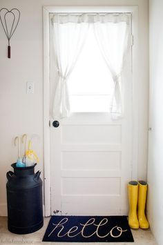 Create a simple farmhouse entry with just a few key items. This tiny farmhouse entry space feels so sweet and welcoming.