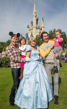 REBECCA ROMIJN & JERRY O'CONNELL - Family picture in front of the castle wearing a Mickey Mouse Club hat