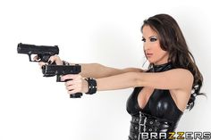 Kortney Kane in a shooting pose with two guns #FemmeFatale