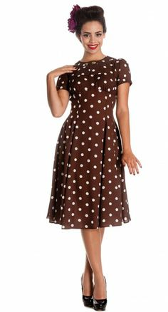 This charming tea dress features an all over polka dot print, printed on a beautiful brown chiffon feel fabric. #VintageInspired #BlameBetty