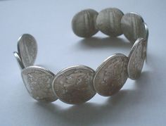 Check out this item in my Etsy shop https://www.etsy.com/listing/227446839/coin-bracelet-bangle-cuff-mercury-dimes