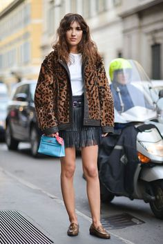 A leopard print jacket and fringe leather skirt.