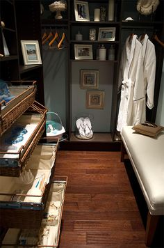 Spa-Like Closet  Wicker basket drawers keep closet essentials at hand in the Dream Home 2008 master bedroom closet. The open shelving makes the small space feel more open, and wooden hangers, spa-like accessories and a few p… more