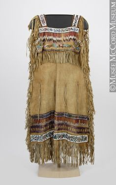 Dress - Plains Aboriginal 1865-1900, Hide, glass beads, paint, fibre 46 x 109 cm