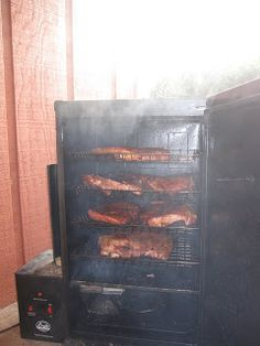 Adding some serious smoke to some delicious ribs. Best way to prepare ribs is in a Bradley smoker! Yum Yum