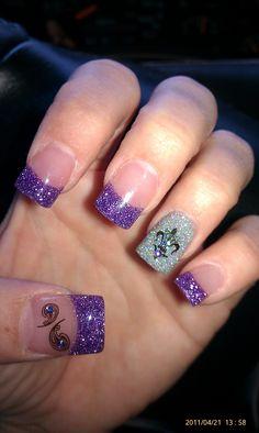 My nails, my art idea: purple glitter, fleur de lis konad stamp art with rhinestone. silver glitter on ring finger, paisley konad stamp w/ jewel on thumb...my fav!