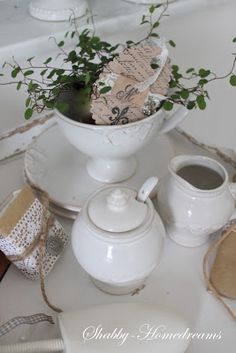Shabby Chic...love white ironstone...especially for the summer....pair with sea shells and greenery.....