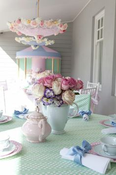 Mary Poppins tea birthday party tables with flower centerpiece and suspended flower parasol