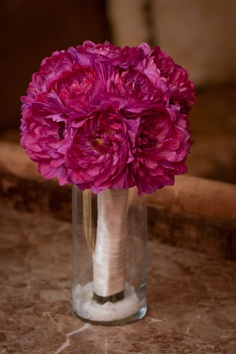 This is a good idea for the wedding party bouquets at the wedding tables.  Have vases ready to allow them to rest and use them as a centerpiece arrangement for that particular table(s)
