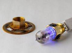 This is so beautiful that I am going to have to include it as jewelry. It is a work of art! Steampunk USB drive vintage glass vacuum tube by steampunknation, $149.00