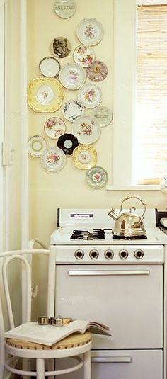 plates wall display..hubby would not approve! But I love it!