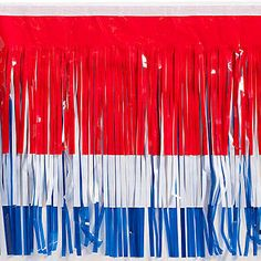 Red White and Blue Vinyl Fringe is an essential part of your parade float decorating! Make colorful parade floats with this shiny fringe that measure 15 inches by 10 feet long.