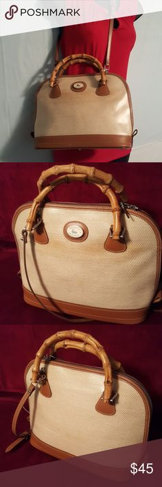 """Vintage Dooney & Bourke Bamboo Tote GUC Vintage Dooney & Bourke  Panama Collection w/Bamboo Designs Inside zipper compartment and slip pocket Zip Around Closure  Bamboo Handles Key finder  Protective Feet Removable Adjustable Straps  13""""L x 9""""H  Some Color Change due to aging Scratch on bottom front and on bamboo handle Bamboo Zipper Tabs Missing No rips or tears Dooney & Bourke Bags Shoulder Bags"""