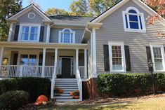 Intellectual Gray, Sherwin Williams Pearly White is the trim, Thunder Gray is the accent (shutters and doors)
