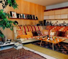 Moon to Moon: Eames house ...  Loving the paneling.  Love the corner unit couch.