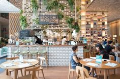 Cafe, bookstore, coworking space and more in this beautifully designed space - Venues - HereNow Bangkok Bookstore Design, Counter Design, Coworking Space, Coffee Shops, Open House, Brewery, Bangkok, Traveling By Yourself, I Am Awesome