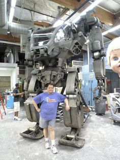 Special Effects Character Creator Gary Yee poses with the metallic star of AVATAR at Stan Winston Studio.