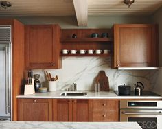 Simple bleached-mahogany kitchen cabinetry