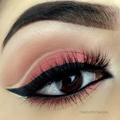 Pink eyeshadow with a black wing.