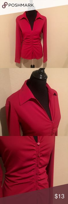 Super cute red button up blouse Red button up blouse with long sleeve. Polyester blend and machine washable. Super cute with slacks or jeans and boots. Worn a couple of times. EUC. New York & Company Tops Button Down Shirts