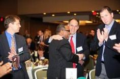 Robert Lewis Jr. congratulated by Alan Khazei and others at the recent Social Capitalist Luncheon.