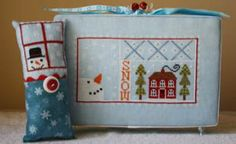 Winter Awwwe by Needle Bling Designs is a nice winter cross stitch pattern with snowman, snow, a house with a fire warming it. The cross sti...