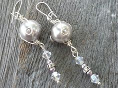 Lustful. Coming to my Etsy shop later! These earrings feature glass Swarovski pearls in light mauve, Swarovski crystals in Clear Midnight with AB crystal rondell's on  925 silver plated earring wires.