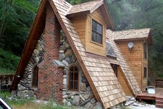 Small A-Frame House with brick, rock and wood