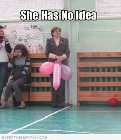 teacher holding balloons has no idea looks like penis