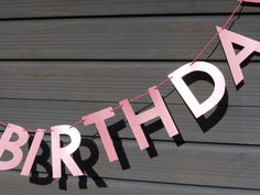 Happy birthday banner in pearlised pink paper  Letter banners in our store paperstreetdolls.etsy.com  Luxury handmade paper decorations