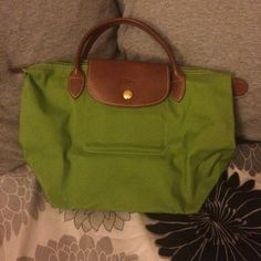 NWOT mini longchamp Bag was purchased in Europe! Never used because I carry too much stuff around to have cute purses :(. Longchamp Bags Totes