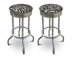 2 Zebra Print Faux Fur 29'' Specialty Chrome Barstools Bar Stools by The Furniture Cove. $144.87. Set of 2 Bar Stools. Chrome Metal Finish. These are new 29'' chrome barstools that have footrests and a swivel seat. The seats feature Zebra Print Faux Fur upholstery. The sides of the seat have nice metal work and there are feet protectors on the bottom of each leg. These are great for kitchen or shop, or spread around a game room or patio setting. In this listing you will recei...