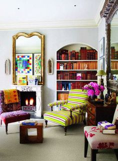 By displaying books in a warm, coordinated color palette, the built-in bookcase becomes a work of art in itself. Source: Elle Decor