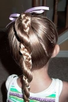 Divide a high ponytail into two sections. Twist one section, braid the other, and then twirl and secure at the end.