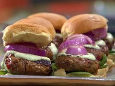 Indian Lamb Burgers with Green Raita Sauce and Red Onions from FoodNetwork.com