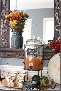love this apple cider drink station .. Have a bottle of caramel vodka for 21 and ups to add to cider Also mason jar w cinnamon sticks and cider glasses