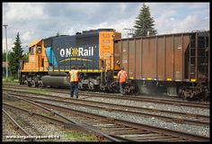 With SD40-2 1735 on point and slowly rolling forward, crews begin dumping ballast in Iroquois Falls Yard June 13th.