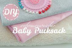 Anleitung und Schnittmuster für einen selbst genähten Baby Pucksack als Geschenk zur Geburt