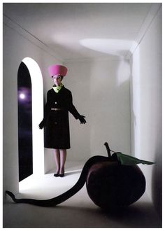 """""""Snake and Apple"""",coat by Zelinka Matlick, Harper's Bazaar, July 1964 photo by Melvin Sokolsky. Giant apple in a surreal white room set - eight years before Magritte like explorations by Sam Haskins which used the same elements but with a very different artistic signature."""